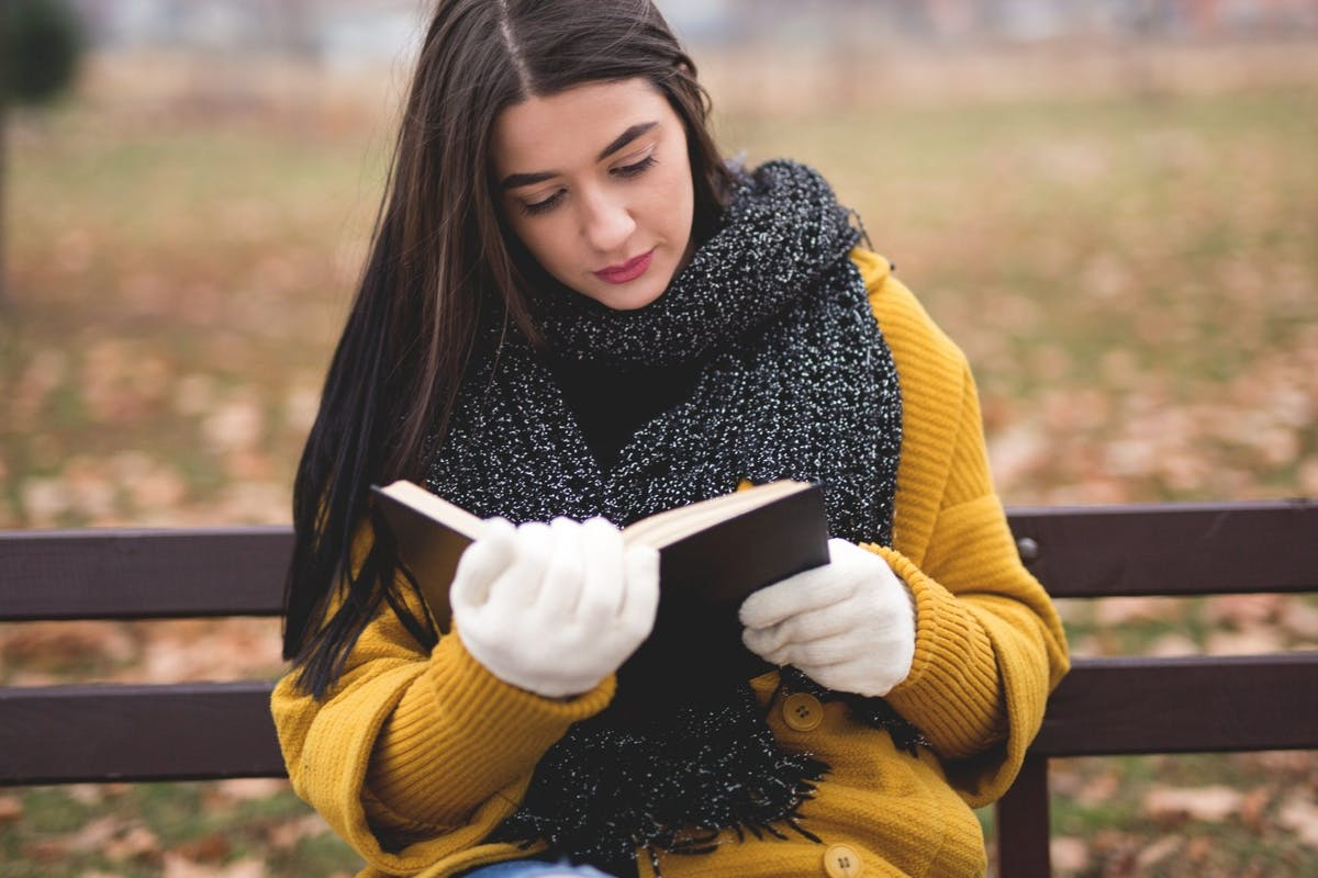 Woman-reading-book-in-winter-
