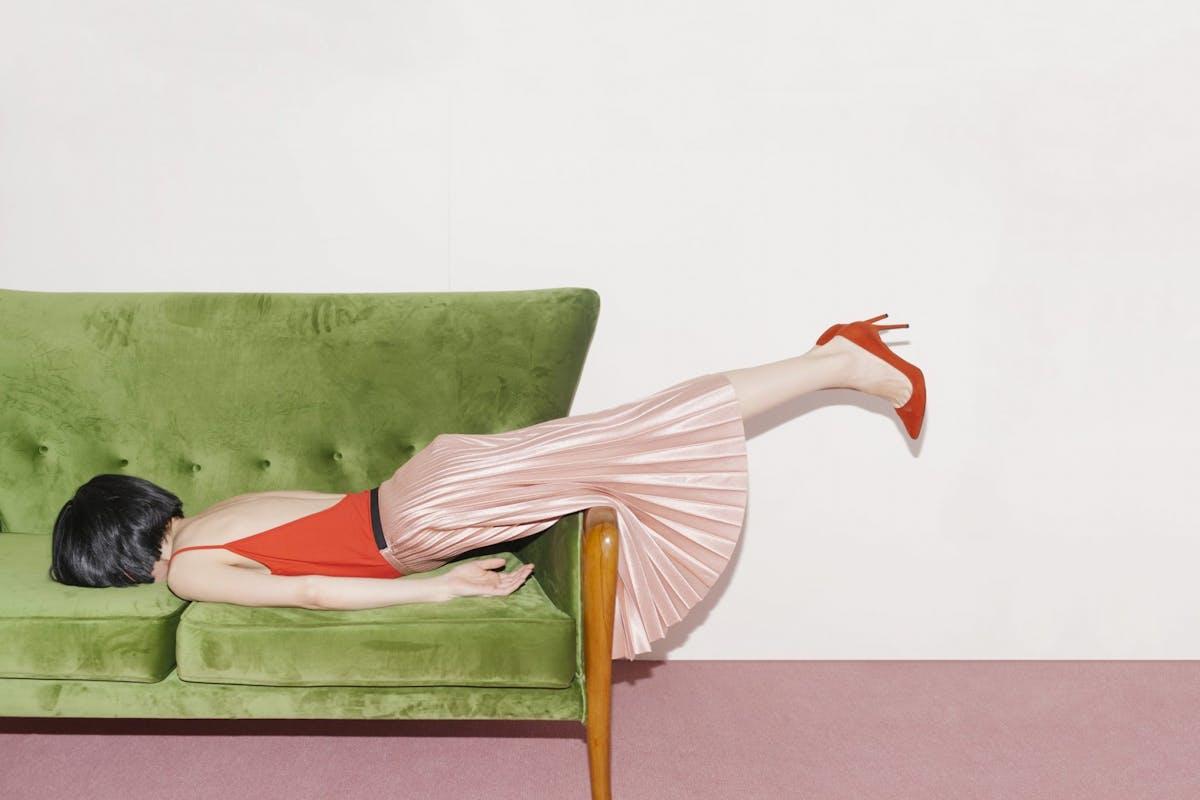 Woman asleep on a sofa