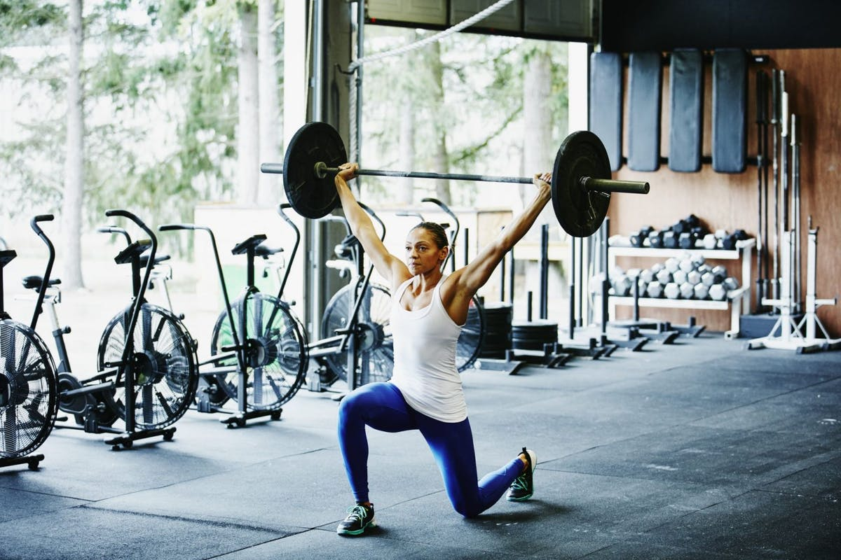 Woman weightlifting in a gym
