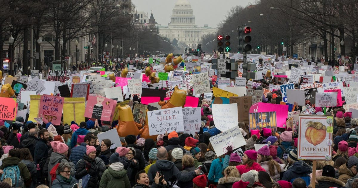 The US National Archives has been caught blurring anti-Trump signs from a Women's March photo