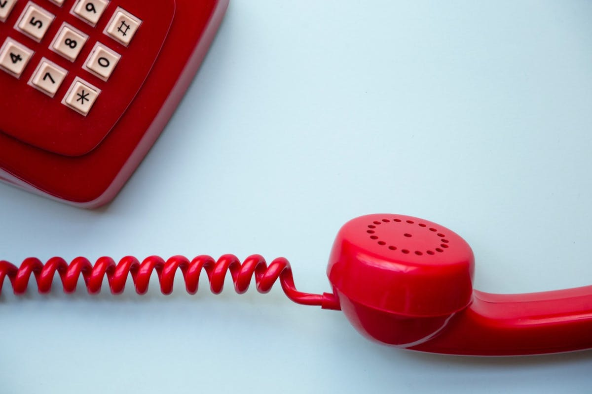 red vintage phone off the hook.