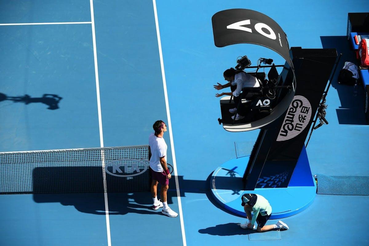 Roger Federer of Switzerland talks to chair umpire Marijana Veljovic during his Men's Singles Quarterfinal match against Tennys Sandgren of the United States on day nine of the 2020 Australian Open