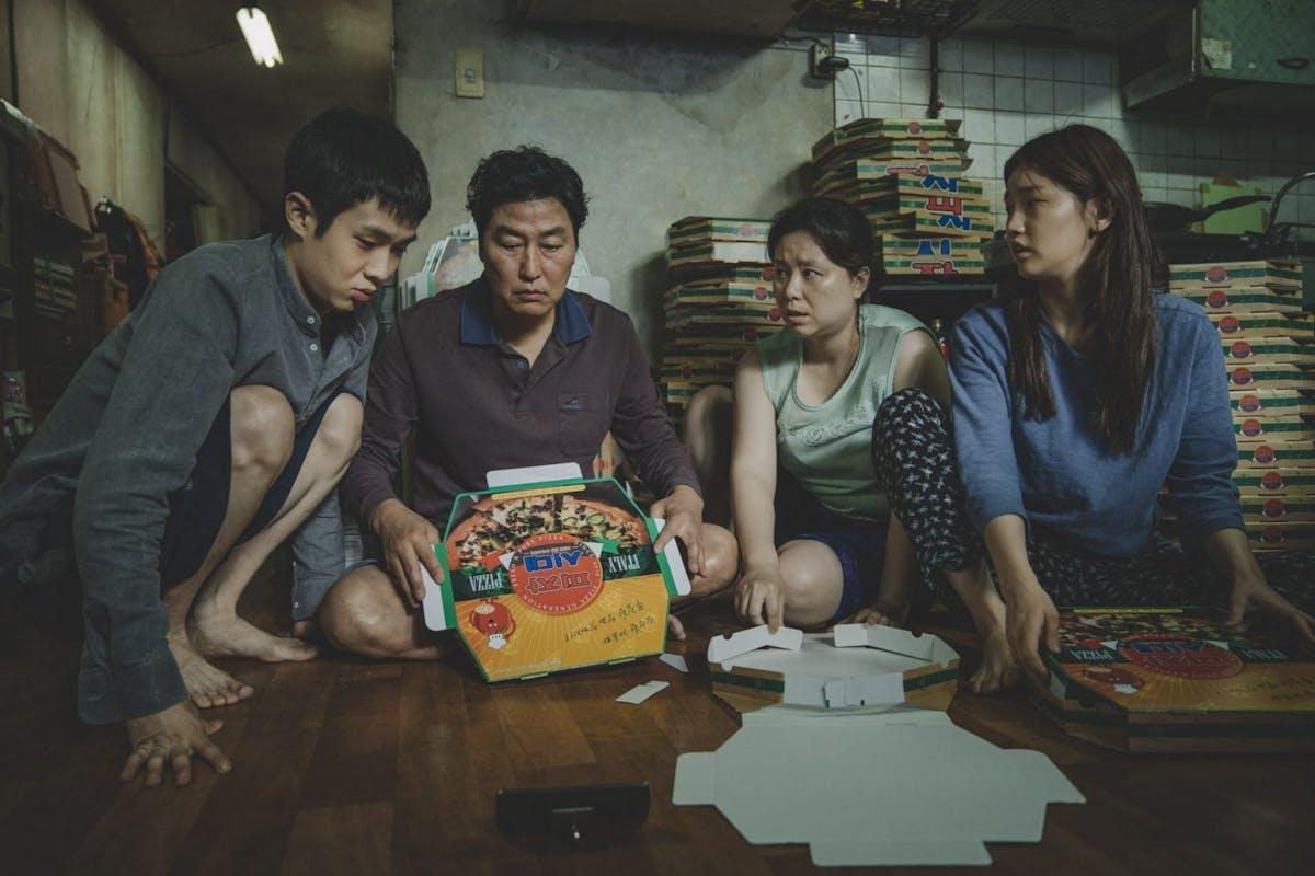 Parasite: Kim Ki-woo (Choi Woo-shik), Ki-jeong (Park So-dam), Ki-taek (Song Kang-ho), and Chung-sook (Chang Hyae-jin)