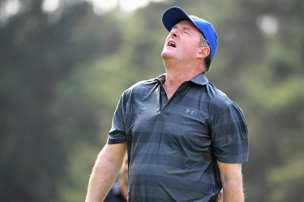 Piers Morgan throws his head back in disappointment during a game of golf