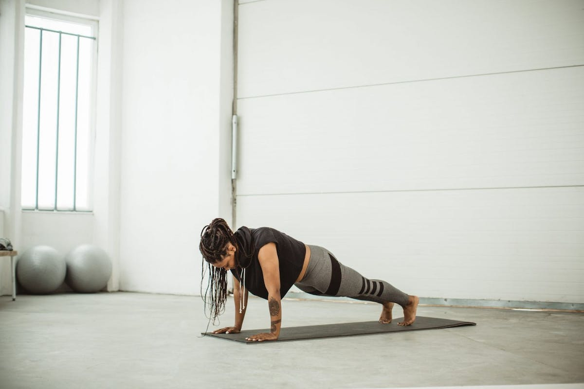 Woman performing a press up