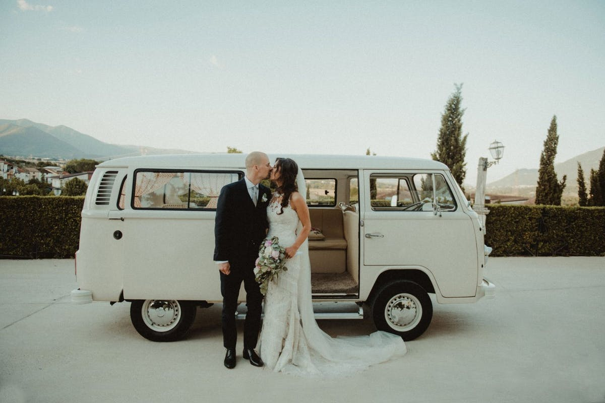 Bride and groom campervan