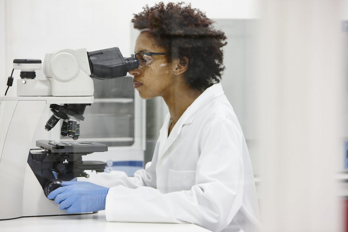 A woman working as a scientist
