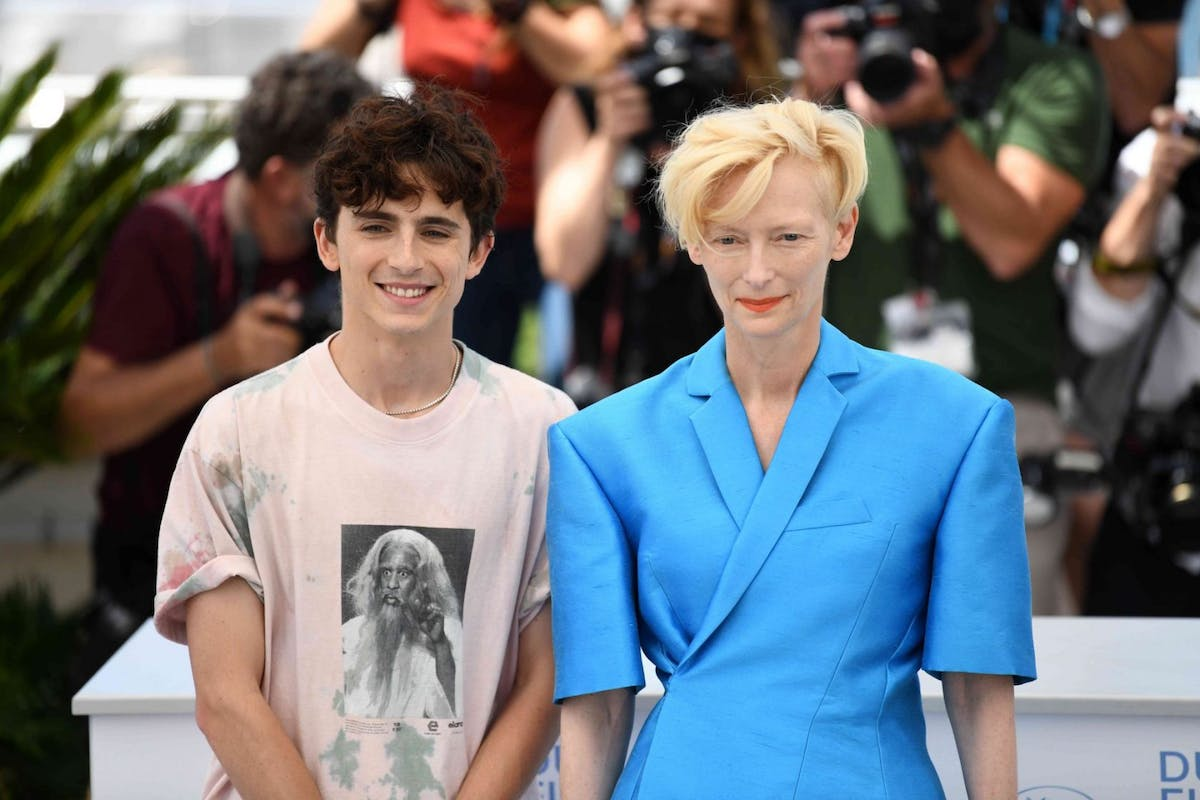 """Timothee Chalamet and Tilda Swinton attend the """"The French Dispatch"""" photocall during the 74th annual Cannes Film Festival on July 13, 2021 in Cannes, France. (Photo by Li Yang/China News Service via Getty Images)"""