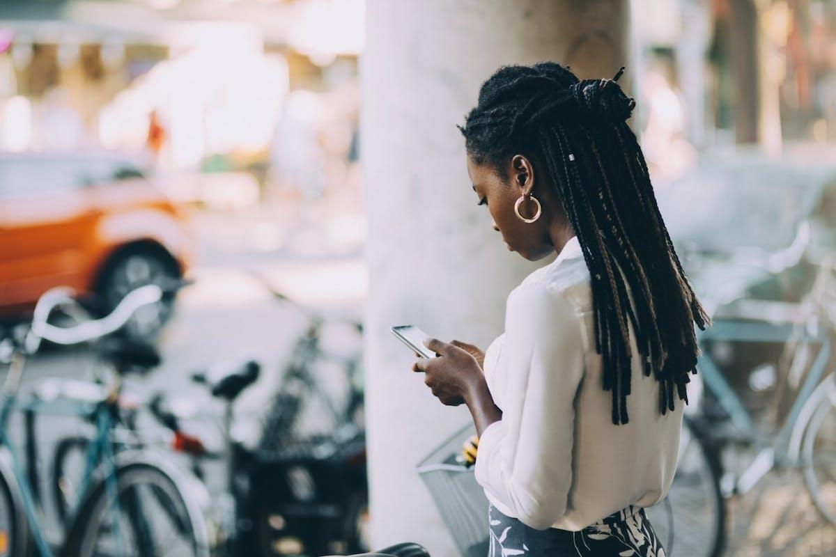 A woman scrolling on social media