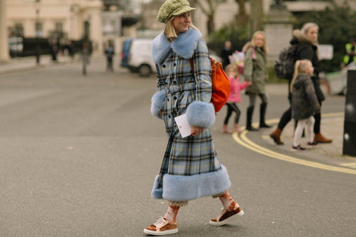 LFW street style: a show goer wears a statement check coat