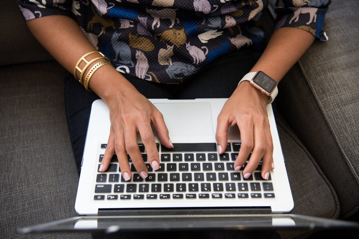 A woman on her computer taking an online course.
