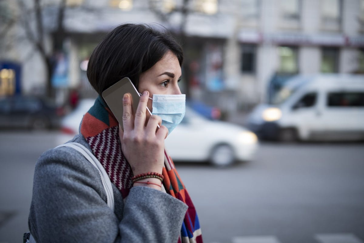 A woman with a surgical mask on