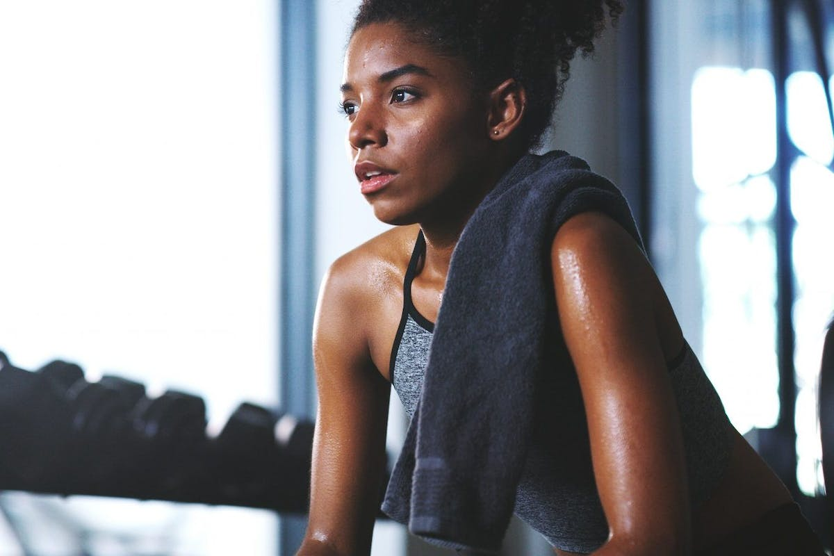 woman sweating in the gym after hiit class