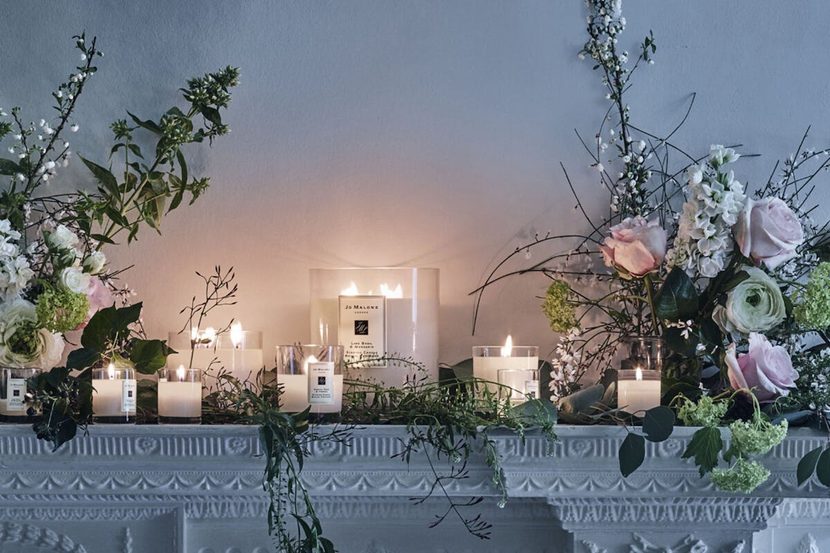 Jo-Malone-London-candles-on-fireplace-with-flowers