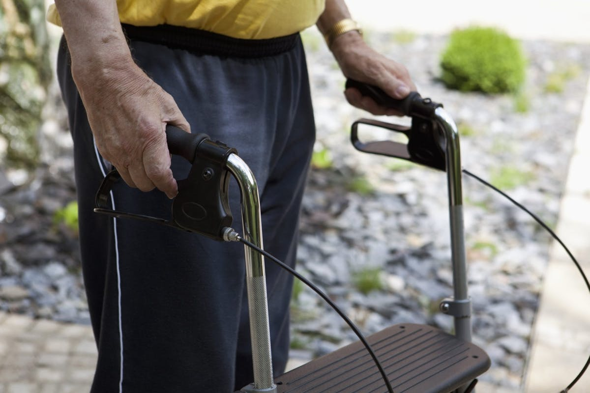 A man walking with a walker