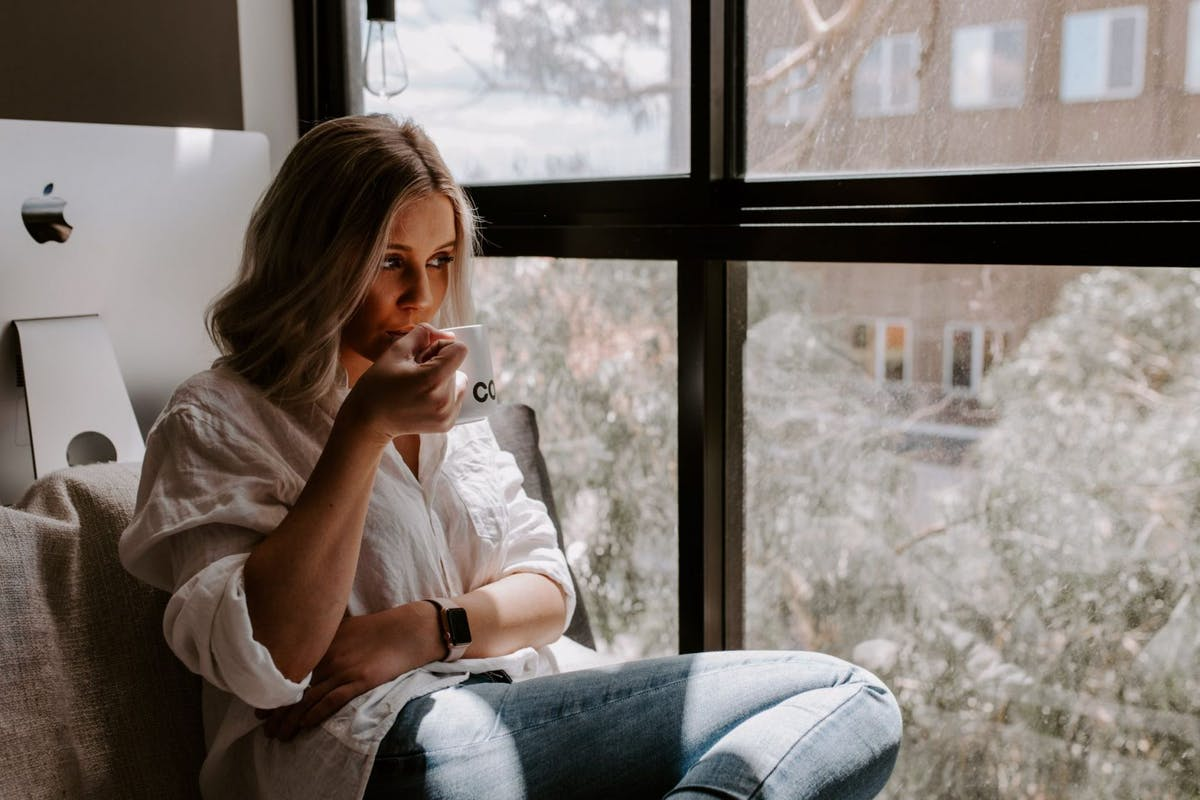 Woman at window watching outside world