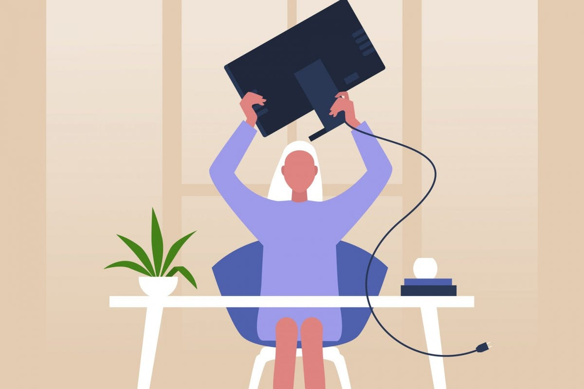 A woman stressed by technology while working from home