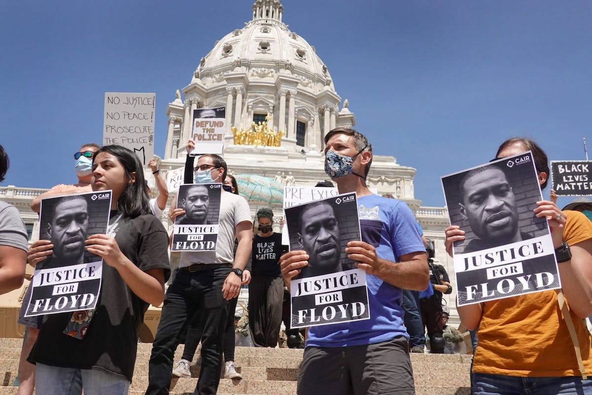 Demonstrators protest outside of the state capital building as unrest continues in the city and around the country following the May 25, death of George Floyd on May 31, 2020 in St. Paul, Minnesota. The state called up 7,500 national guard troops to supplement state and local police, the largest domestic deployment of national guard in the state's history. (Photo by Scott Olson/Getty Images)