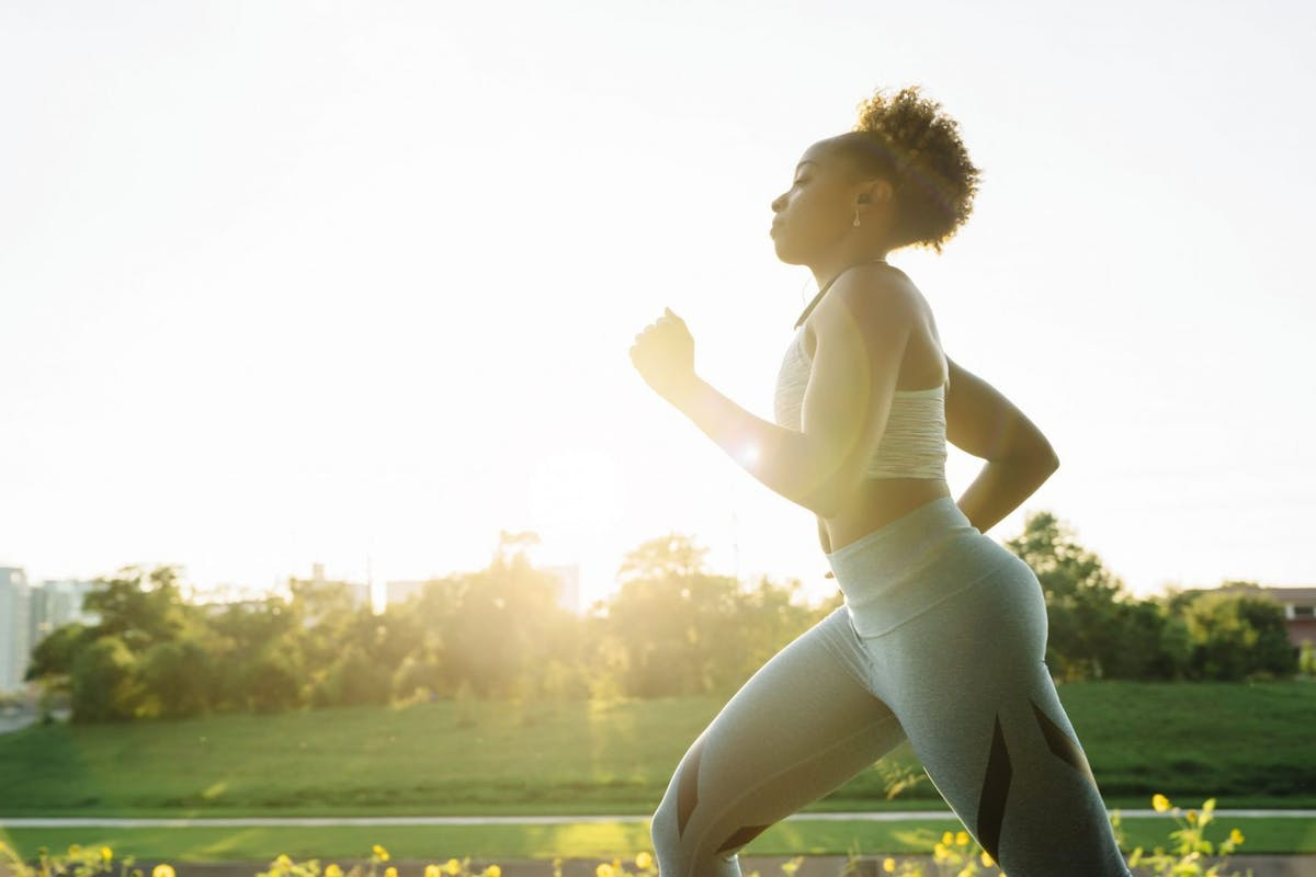 woman running outside after warming up