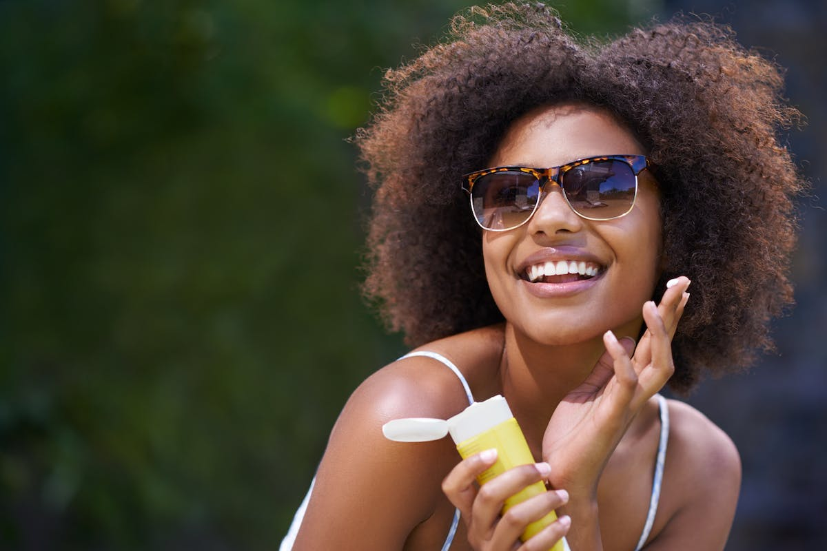 does-sunscreen-expire-woman-applying-SPF