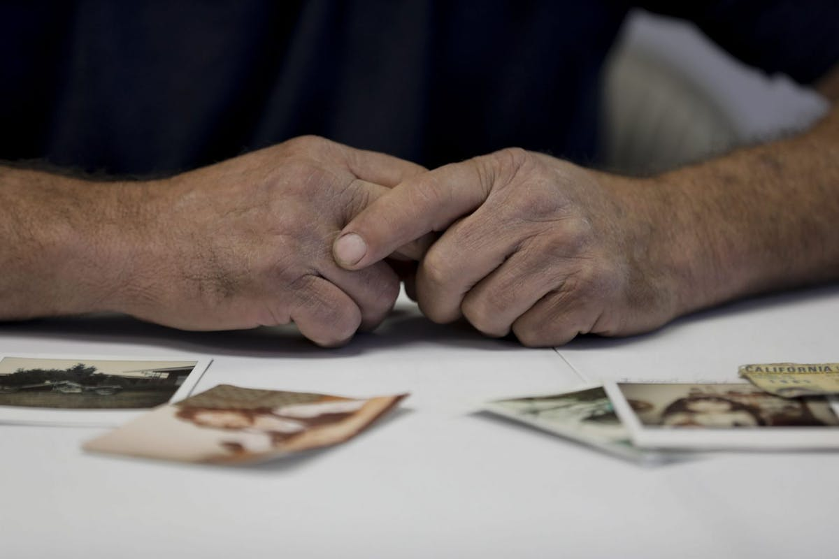 CARMICHAEL, CA - JUNE 14: The weathered hands of Victor Hayes, a survivor of the East Area Rapist, photographed with old pictures of himself in the foreground during an interview in Carmichael, Calif., on Thursday, June 14, 2018. Joseph James DeAngelo who was arrested nearly two months ago is the man accused of being the East Area Rapist and later the Golden State Killer. (Randy Vazquez/Bay Area News Group via Getty Images)
