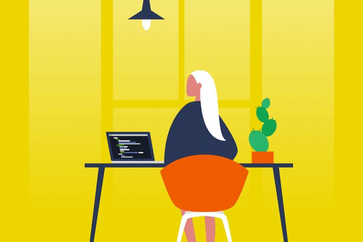 A woman sat at a desk
