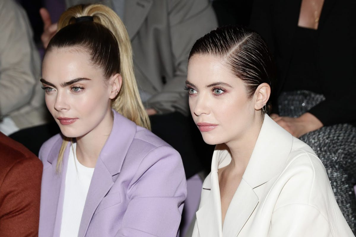 Cara Delevingne and Ashley Benson attend the BOSS fashion show during the Milan Fashion Week Fall/Winter 2020 - 2021 on February 23, 2020 in Milan, Italy. (Photo by Vittorio Zunino Celotto/Getty Images for Hugo Boss )