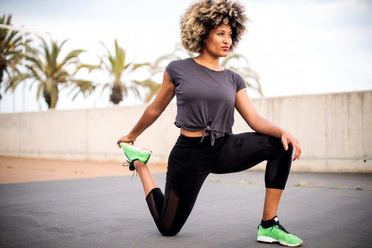 Woman stretching after running
