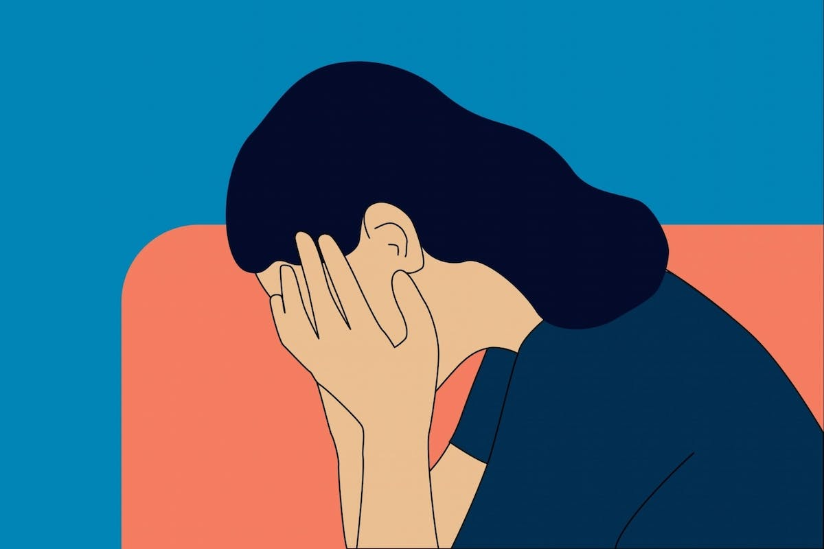 A woman grieving