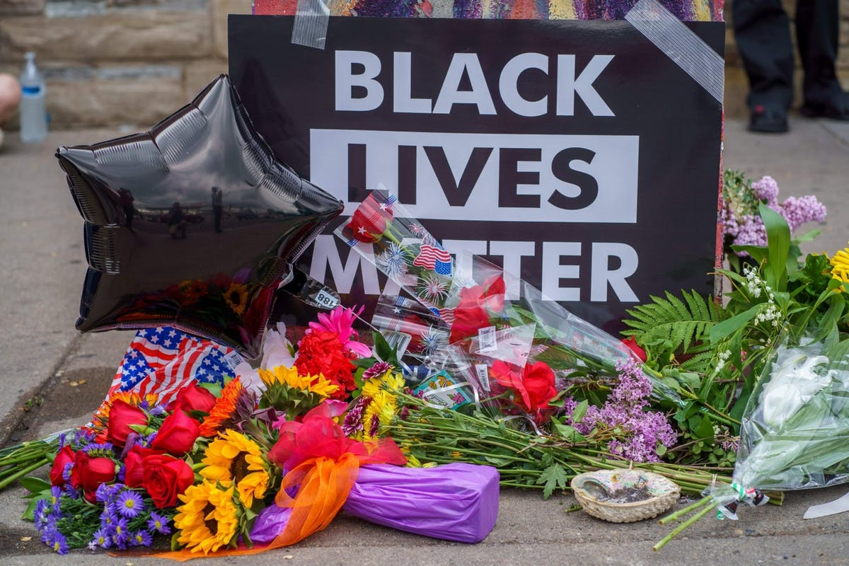 Black Lives Matter memorial sign at the site of where George Floyd was killed by white police officers