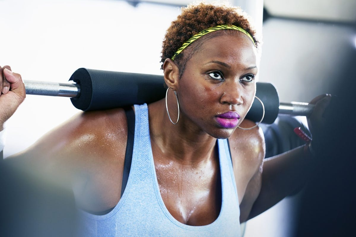 woman under a barbell