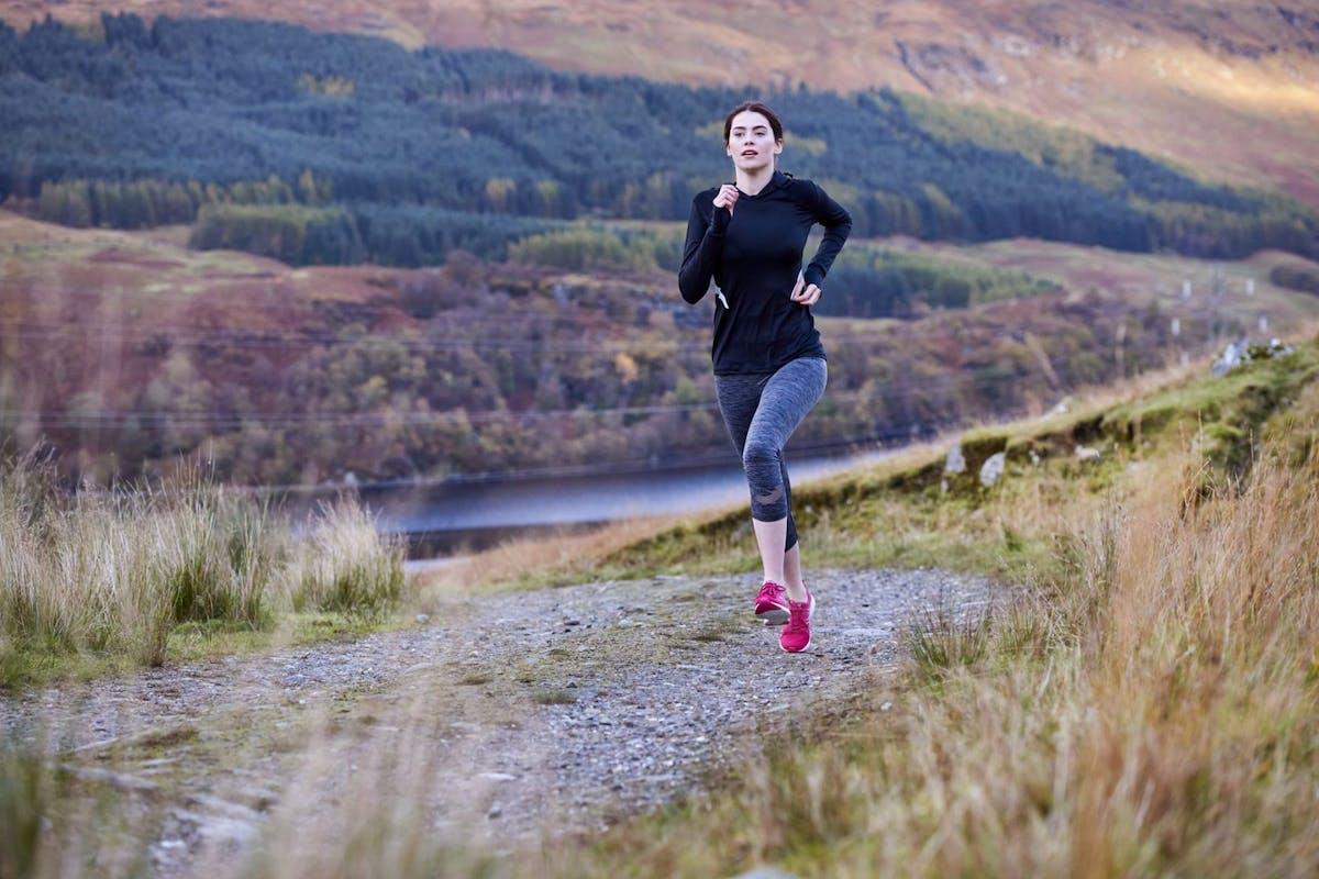 Woman running in scenery