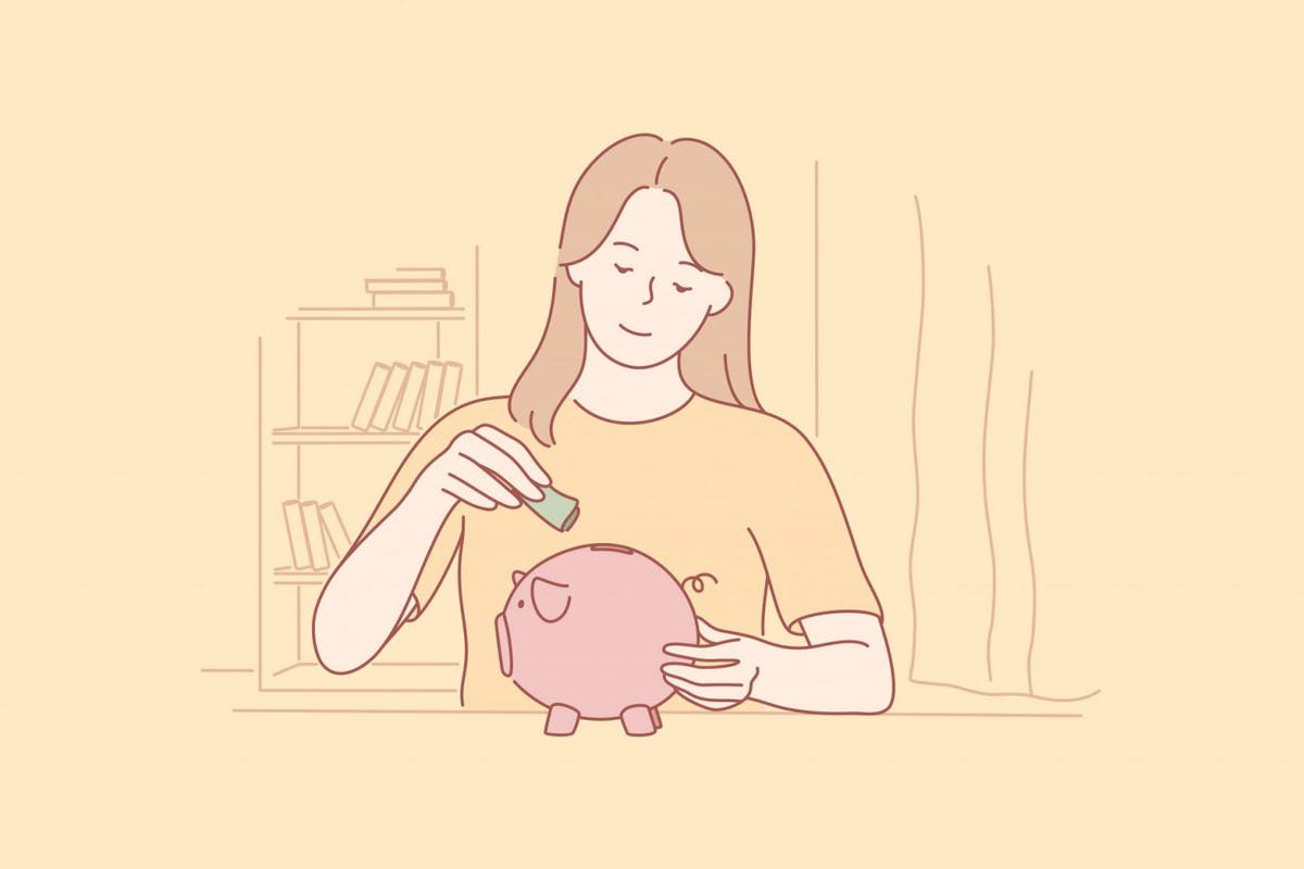 A woman putting money in a piggy bank