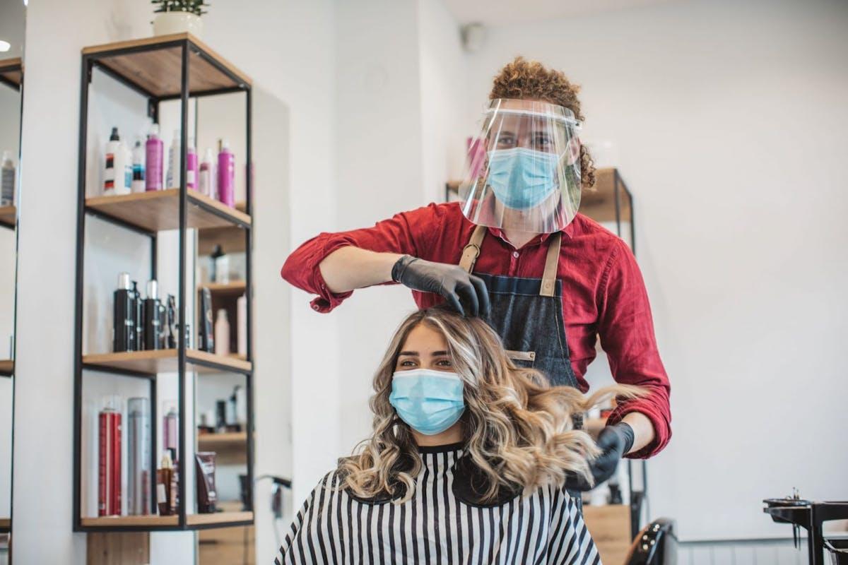 A lady getting her hair cut in a salon