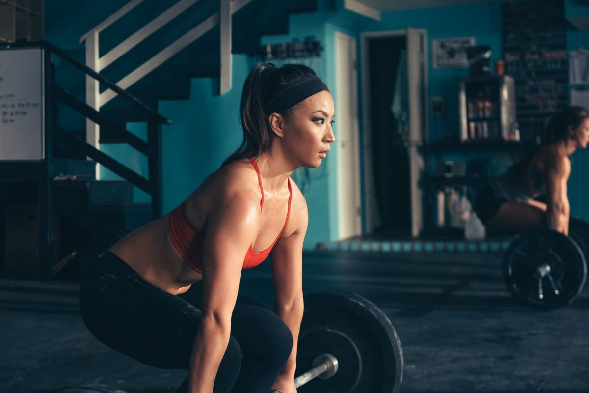 woman gym weight lifting