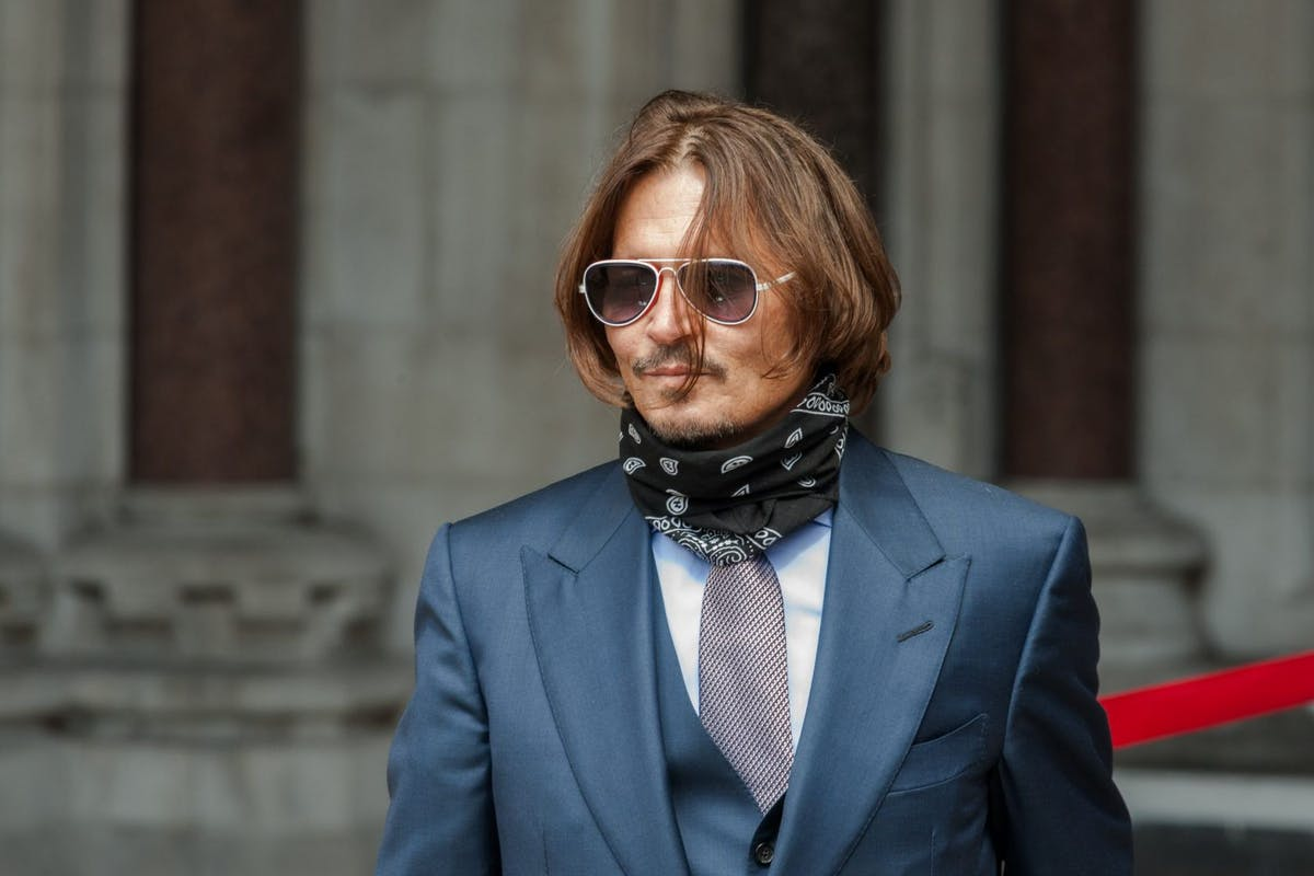 "Johnny Depp arrives at the Royal Courts of Justice, Strand on July 20, 2020 in London, England. The Hollywood Actor is suing News Group Newspapers (NGN) and the Sun's executive editor, Dan Wootton, over an article published in 2018 that referred to him as a ""wife beater"" during his marriage to actor Amber Heard. (Photo by Peter Summers/Getty Images)"