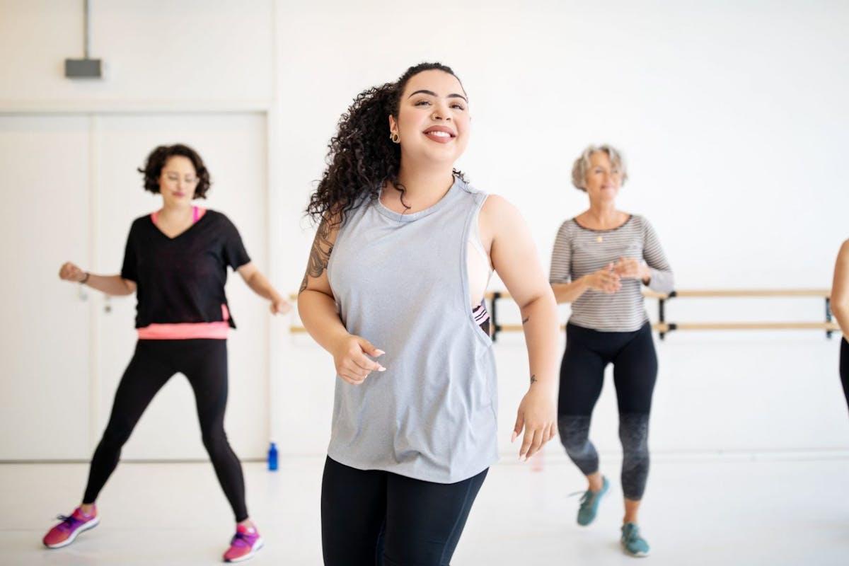 Women exercising in class