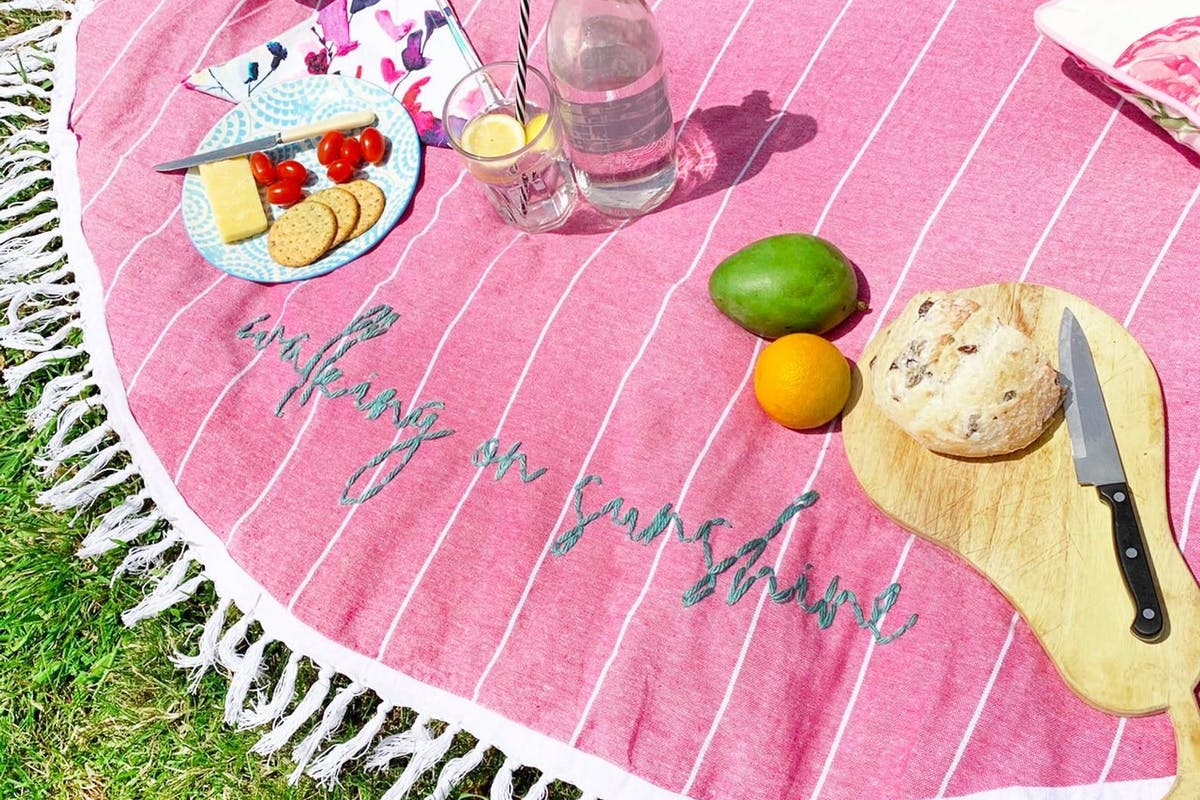 Embroidered picnic blanket