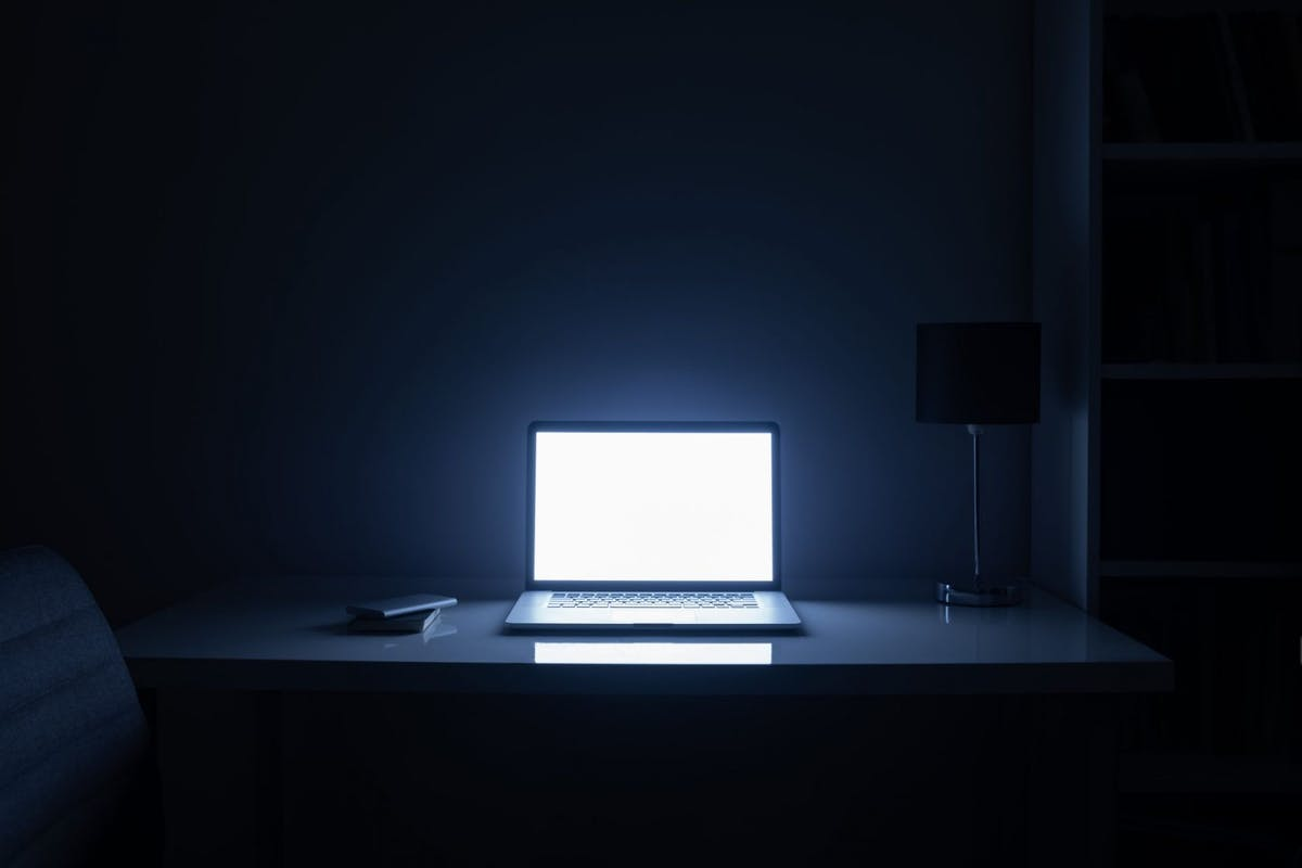 The Host: Illuminated Laptop On Table At Home - stock photo