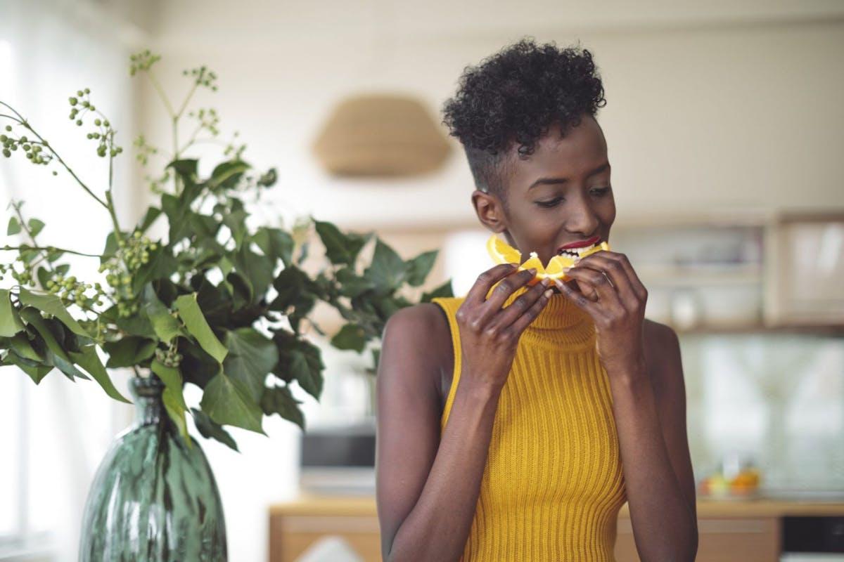 Woman eating an orange