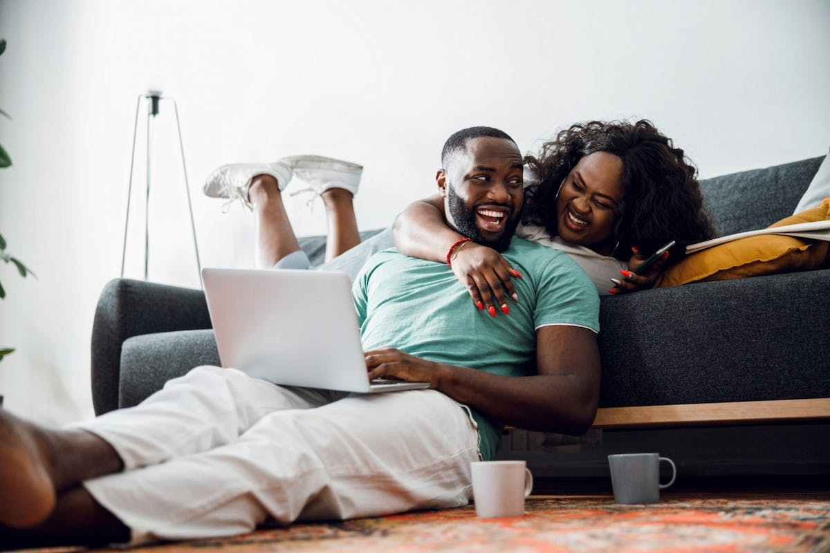 An image of a couple laughing in their new home