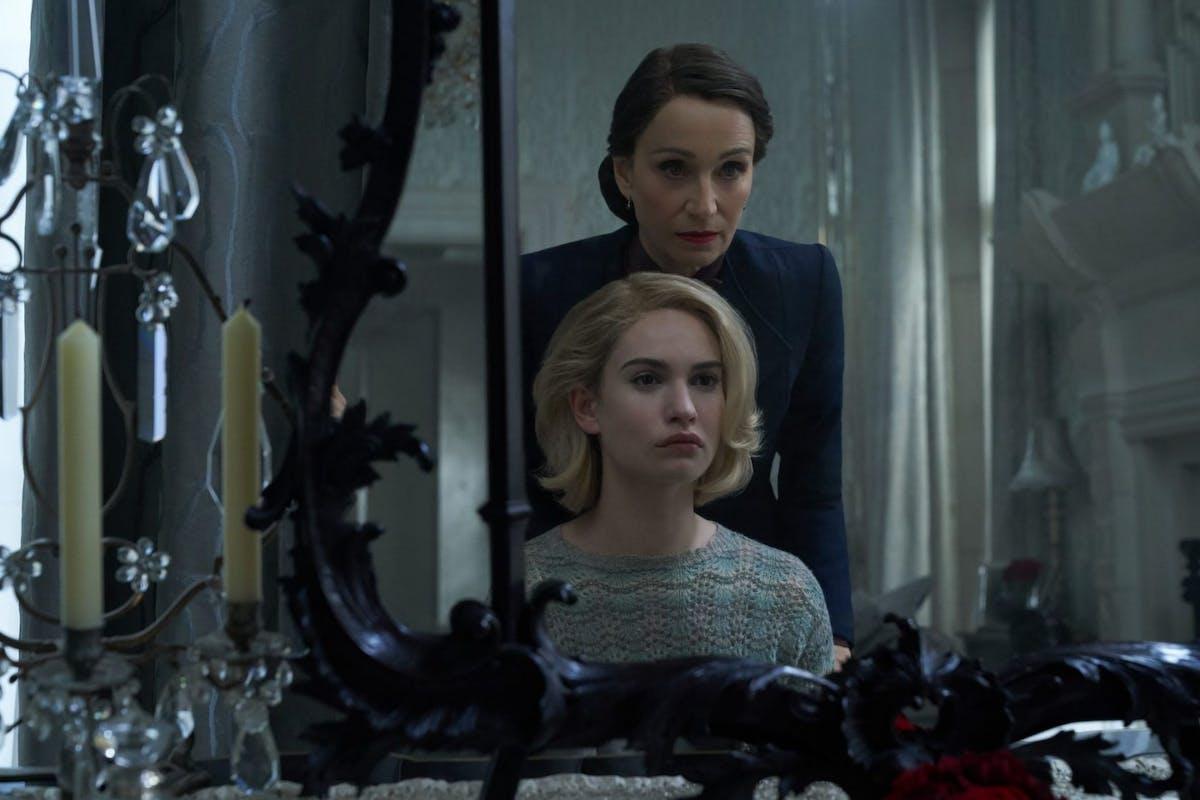 Netflix's Rebecca: Kristin Scott Thomas and Lily James as Mrs. Danvers and Mrs de Winter.