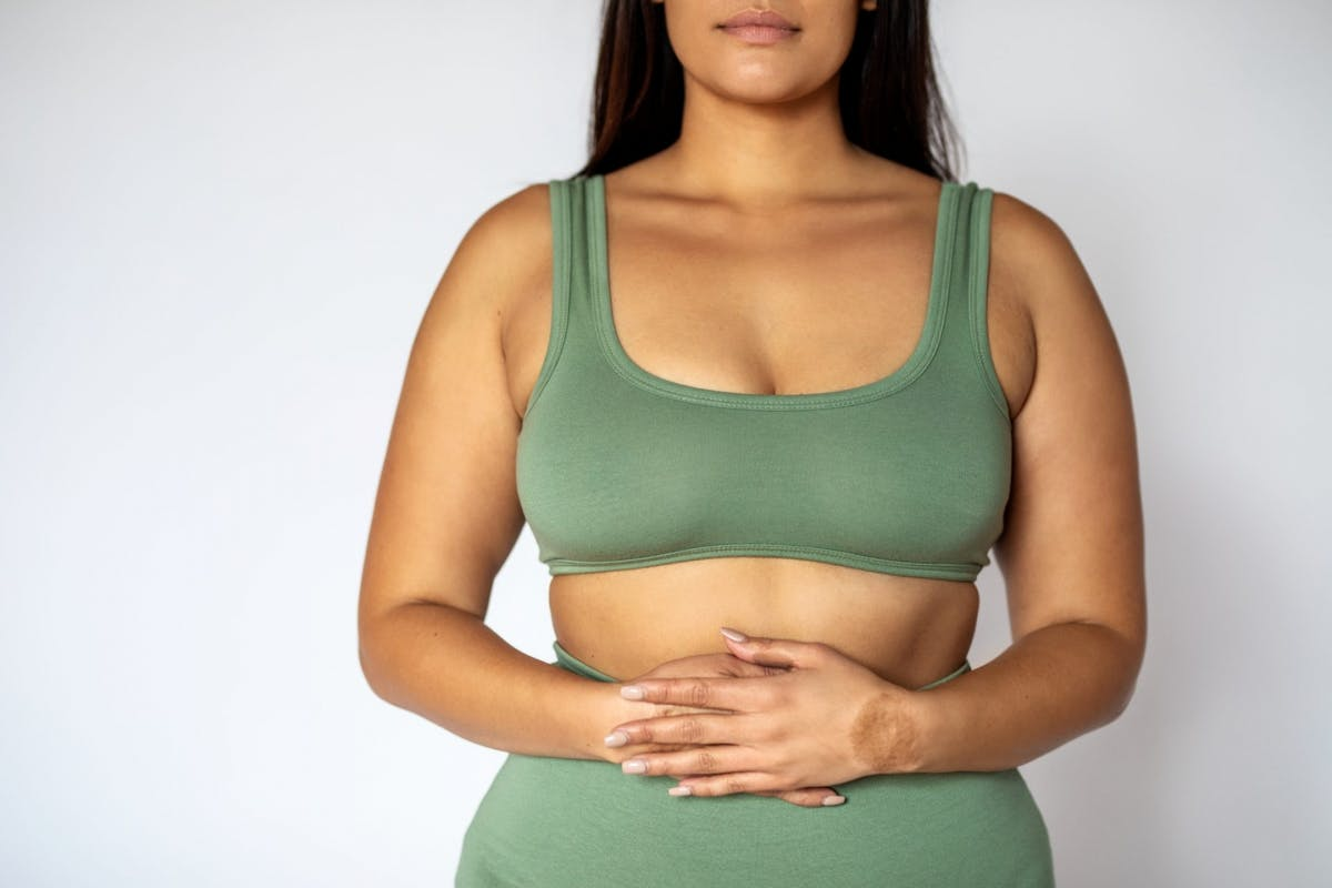 woman holding stomach digestion