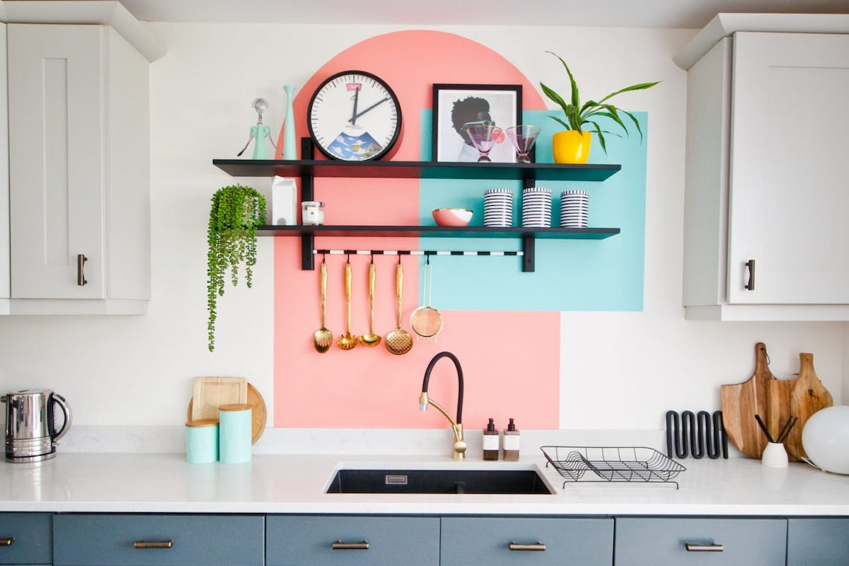 A kitchen with a painted arch