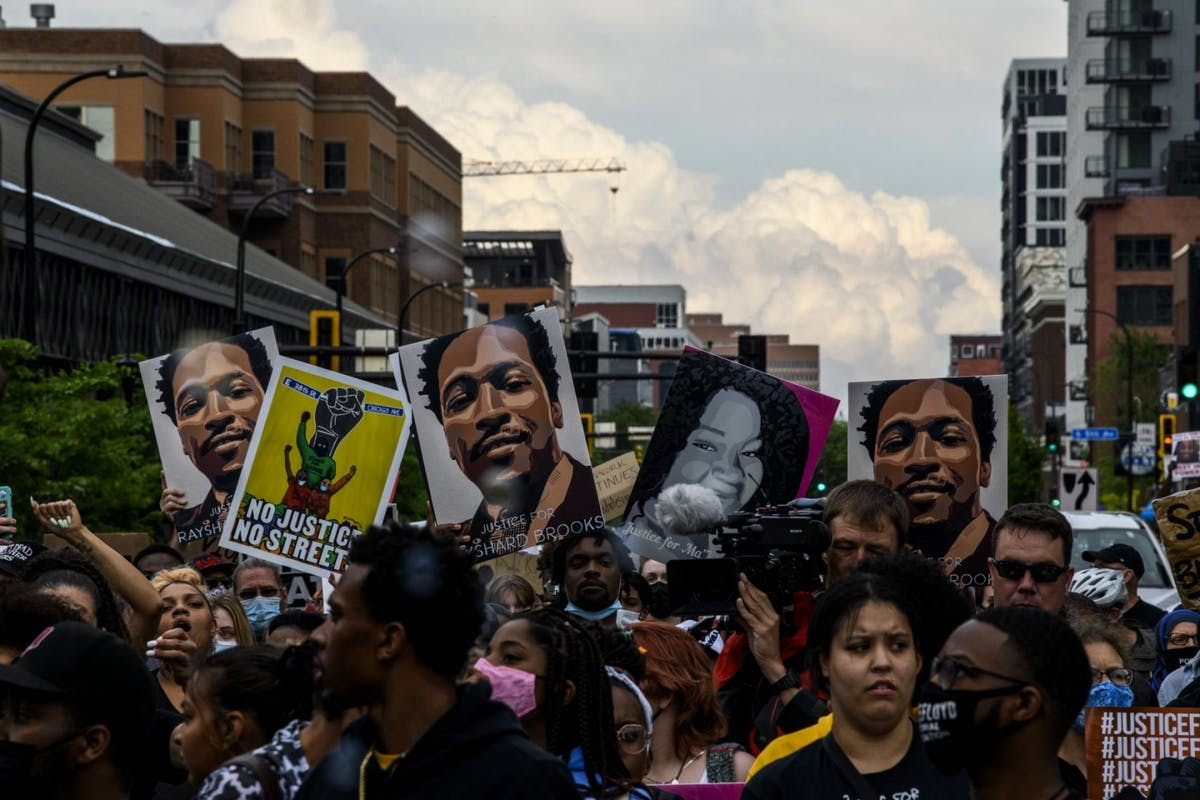 MINNEAPOLIS, MN - MAY 23: People march in honor of George Floyd on May 23, 2021 in Minneapolis, Minnesota. The National Action Network and members of George Floyd's family hosted an inaugural remembrance to honor the life of Floyd, who was killed by former Minneapolis police officer Derek Chauvin on May 25, 2020. Chauvin has since been convicted of multiple murder counts in Floyds death. (Photo by Stephen Maturen/Getty Images)