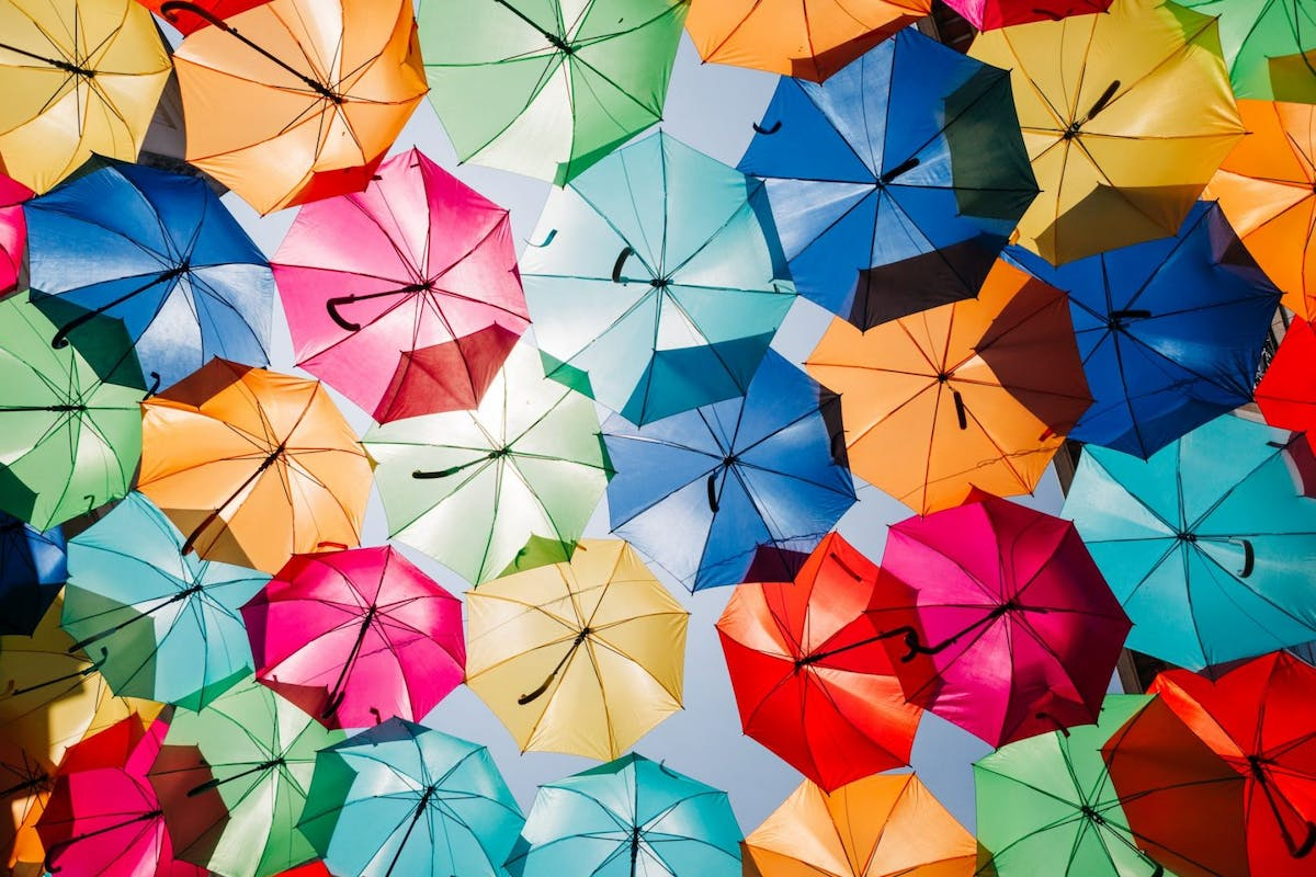 August bank holiday 2020 ideas: Low Angle View Of Colorful Umbrellas Hanging Outdoors - stock photo