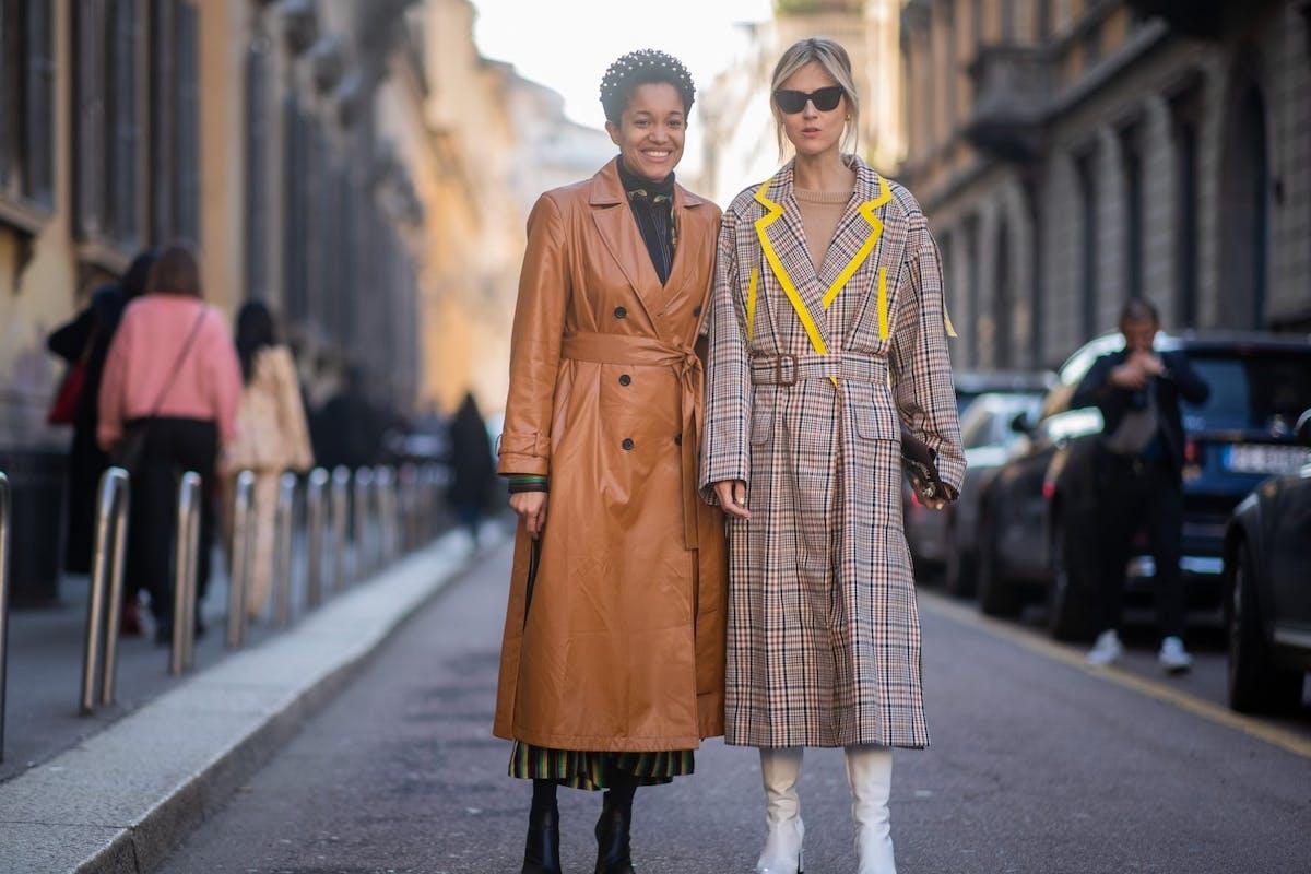 Tamu and Linda wearing trench coats
