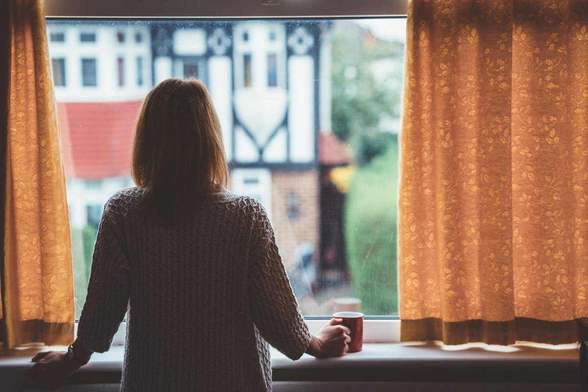 A woman looking out her window