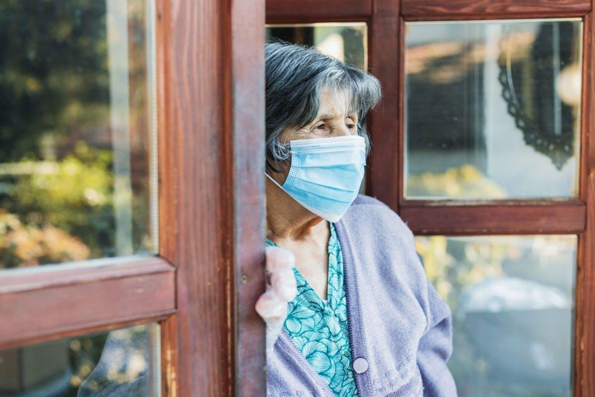 Senior woman with facial mask - stock photo