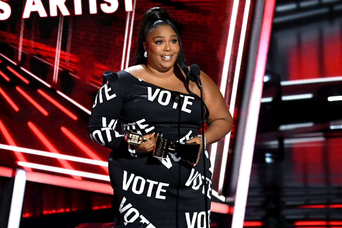 Lizzo accepting the award for Top Sales Artist at the Billboard Music Awards